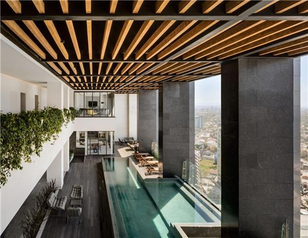 Andares凯悦酒店及公寓塔楼  / Sordo Madaleno Arquitectos#架空层 #建筑空间 #木柱